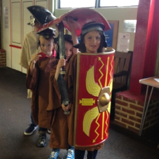picture of children dressed up as Roman soldiers